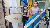 Students holding surf boards